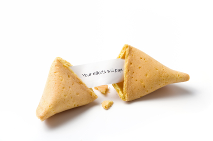 a broken fortune cookie isolated on white with message