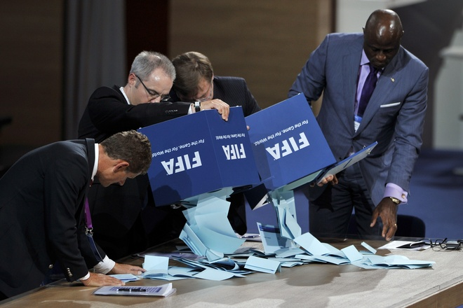 Ushers empty  ballot boxes during presidential voting on June 1, 2011 at the 61st FIFA congress at the Zurich Hallenstadion in Oerlikon near Zurich. FIFA president Sepp Blatter is set to be re-elected head of world football, vowing to clean up the body's tarnished image as new questions arise about Qatar's successful bid to host the World Cup finals in 2022.    AFP PHOTO / FABRICE COFFRINI (Photo credit should read FABRICE COFFRINI/AFP/Getty Images)